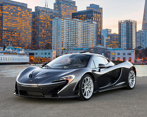AUT 50 RK0051 01 © Kimball Stock 2014 McLaren P1 3/4 Front View On Pavement By City