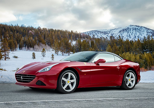 AUT 51 RK0002 01 © Kimball Stock 2015 Ferrari California T Side View On Snowscape