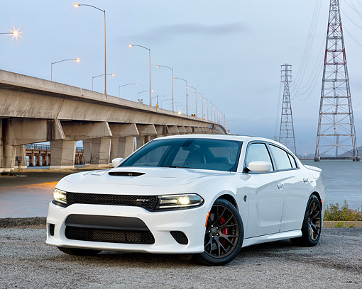 AUT 51 RK0060 01 © Kimball Stock 2015 Dodge Charger SRT Hellcat White 3/4 Front View By Bridge And Water