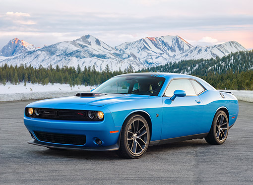 AUT 51 RK0067 01 © Kimball Stock 2015 Dodge Challenger Shaker Blue By Snowy Mountains And Trees
