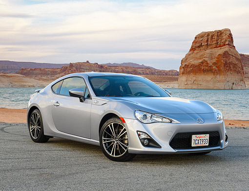 AUT 51 RK0076 01 © Kimball Stock 2015 Scion FR-S Silver 3/4 Rear View By Desert Lake And Mountains