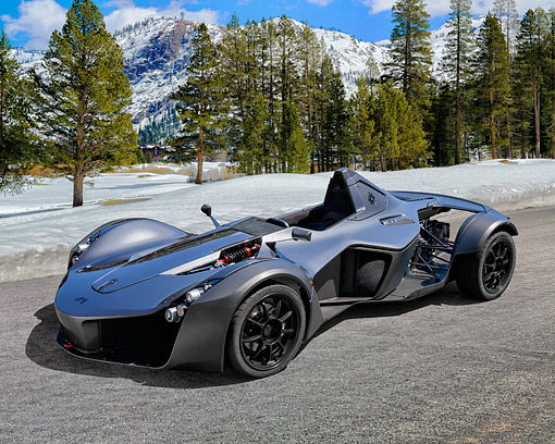 AUT 51 RK0085 01 © Kimball Stock 2015 BAC Mono Single-Seater Road-Legal Supercar Silver 3/4 Front View By Mountain And Trees With Snows