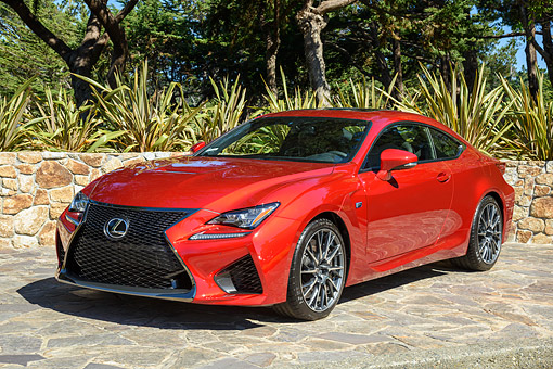 AUT 51 RK0086 01 © Kimball Stock 2015 Lexus RC F Red 3/4 Front View On Rocks By Trees