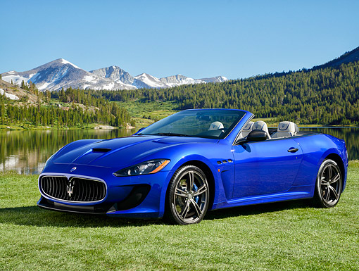 AUT 51 RK0098 01 © Kimball Stock 2015 Maserati GranTurismo MC Edition Blue 3/4 Front View By Mountains And Lake