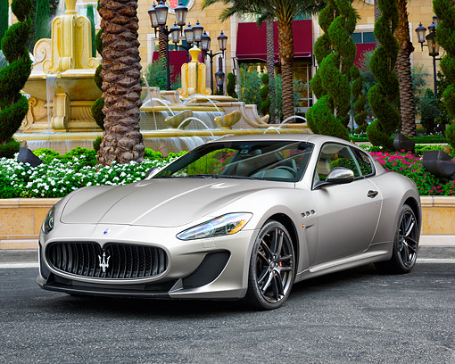 AUT 51 RK0099 01 © Kimball Stock 2015 Maserati GranTurismo MC 3/4 Front View By Trees And Fountain
