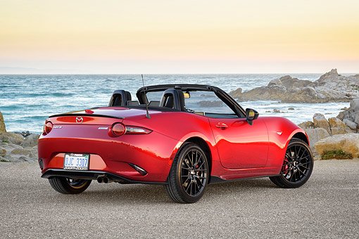 AUT 52 RK0026 01 © Kimball Stock 2016 Mazda MX-5 Miata Red 3/4 Rear View By Beach