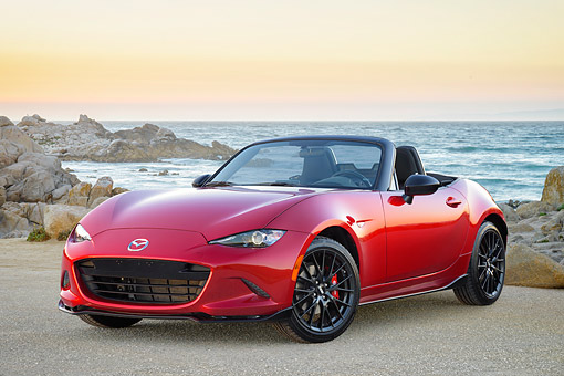 AUT 52 RK0027 01 © Kimball Stock 2016 Mazda MX-5 Miata Red 3/4 Front View By Beach