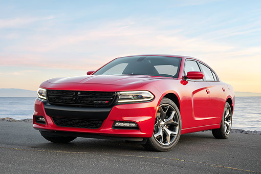 AUT 52 RK0028 01 © Kimball Stock 2016 Dodge Charger SXT Rallye Sedan Red 3/4 Front View By Ocean