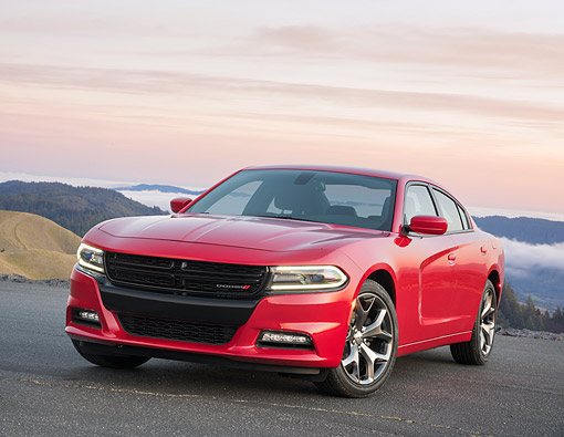AUT 52 RK0029 01 © Kimball Stock 2016 Dodge Charger SXT Rallye Sedan Red 3/4 Front View By Mountains