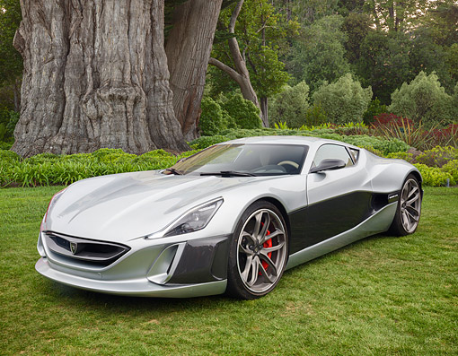 AUT 52 RK0041 01 © Kimball Stock 2016 Rimac Concept One Electric Supercar 3/4 Front View On Grass By Trees