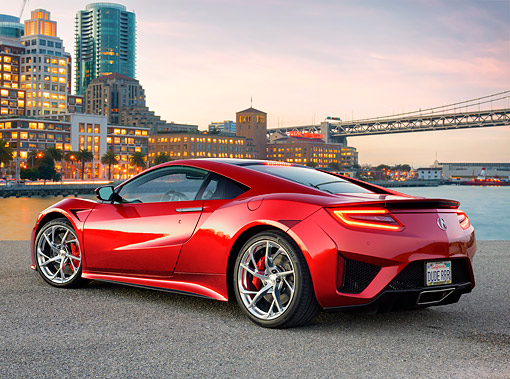 AUT 53 RK0019 01 © Kimball Stock 2017 Acura NSX Hybrid Supercar Red 3/4 Rear View At Edge Of Bay With City In Background