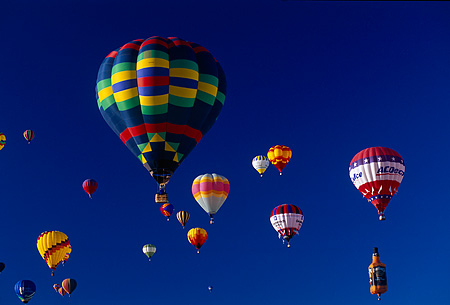 BAL 01 JF0003 08 © Kimball Stock Colorful Hot Air Balloons In Flight Blue Sky