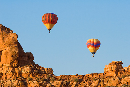 BAL 01 RW0003 01 © Kimball Stock Hot Air Balloons Flying By Desert Mountain