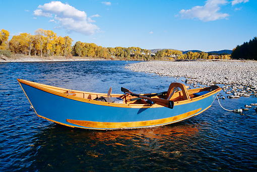 BTS 01 DS0001 01 © Kimball Stock Rowboat In Lake By Rocky Shore