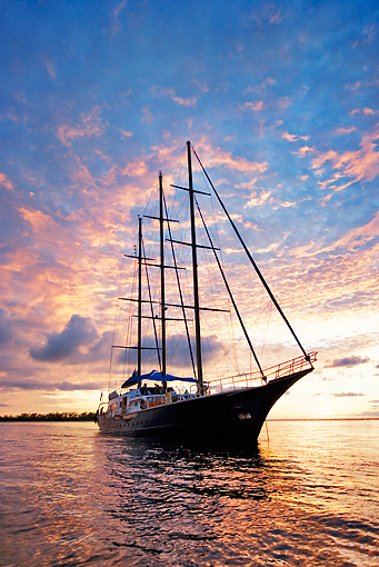 BTS 01 MH0002 01 © Kimball Stock Low Angle View Of Yacht At Sunset