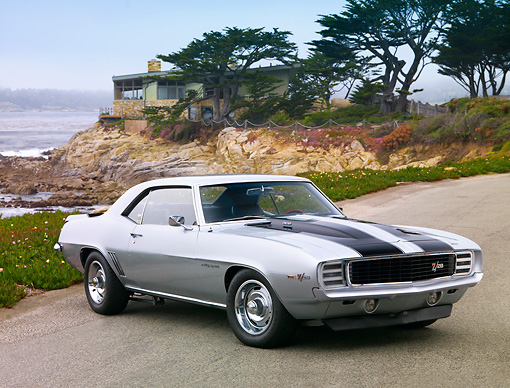 CAM 01 BK0008 01 © Kimball Stock 1969 Chevrolet Camaro Z-28 RS Silver And Black Stripe 3/4 Front View On Pavement By Ocean