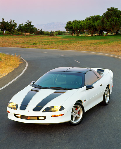 CAM 01 RK0038 01 © Kimball Stock 1994 Chevrolet Camaro Z-28 White With Black Stripes 3/4 Front View On Curve