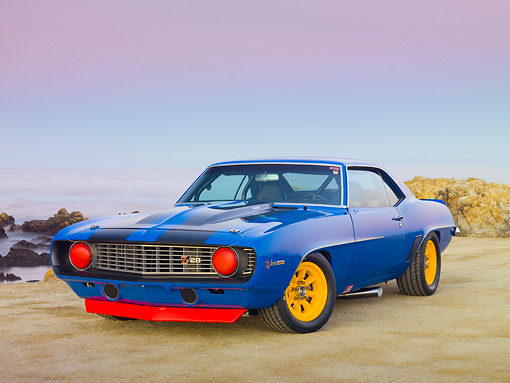 CAM 01 RK0185 01 © Kimball Stock 1969 Chevrolet Camaro Z-28 Blue With Black Stripe And Yellow Wheels 3/4 Front View On Beach