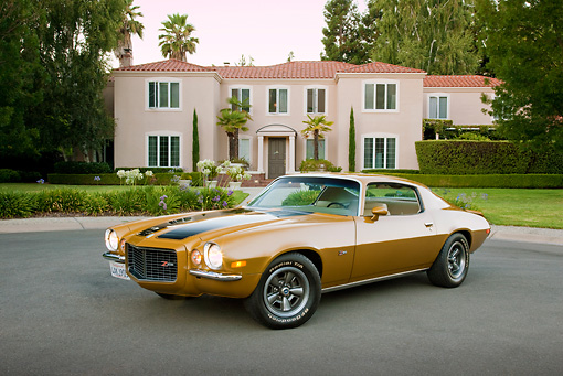 CAM 01 RK0204 01 © Kimball Stock 1970 1/2 Chevrolet Camaro Z-28 Gold With Black Stripe 3/4 Front View On Pavement By House