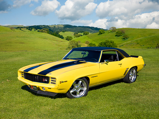 CAM 01 RK0217 01 © Kimball Stock 1969 Chevrolet Camaro Z-28 Yellow With Black Stripes 3/4 Front View On Grassy Hills