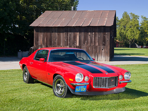 CAM 01 RK0223 01 © Kimball Stock 1970 1/2 Chevrolet Camaro Z-28 RS Red With Black Stripes 3/4 Front View On Grass By Wooden Shed