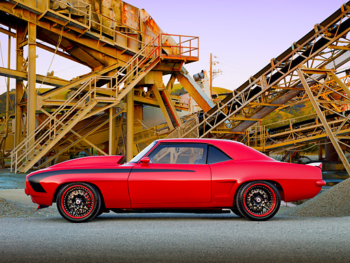 CAM 01 RK0276 01 © Kimball Stock 1969 Chevrolet Camaro Z-28 Red Profile View On Gravel By Rusty Structure