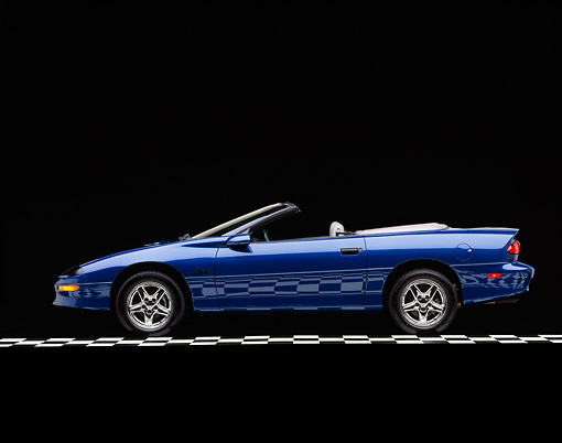 CAM 01 RK0014 03 © Kimball Stock 1997 Chevrolet Camaro Z-28 Convertible Blue Profile View On Checkered Floor Studio