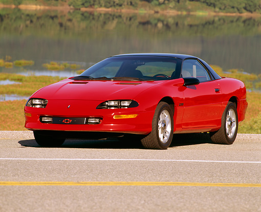 CAM 01 RK0052 05 © Kimball Stock 1993 Chevrolet Camaro Z-28 Red 3/4 Front On Road By Lake