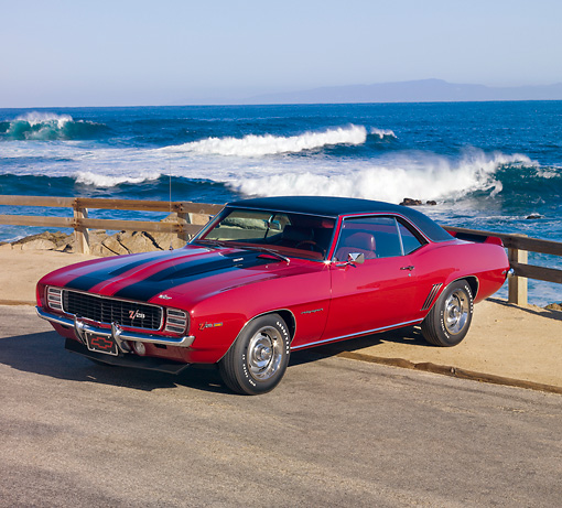 CAM 01 RK0174 01 © Kimball Stock 1969 Chevrolet Camaro Z-28 Red With Black Stripe 3/4 Front View By Ocean