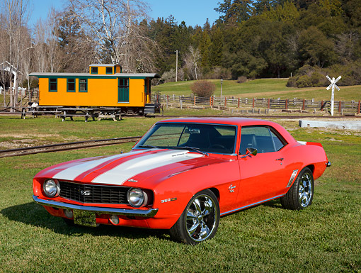 CAM 02 RK0181 01 © Kimball Stock 1969 Chevrolet Camaro SS Red With White Stripes 3/4 Front View On Grass By Railroad