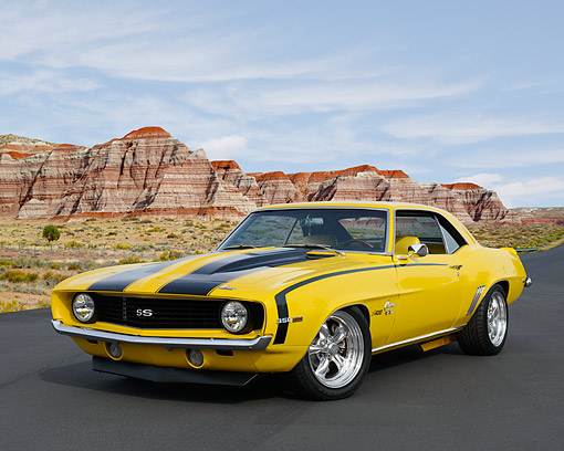 CAM 02 RK0187 01 © Kimball Stock 1969 Chevrolet Camaro SS Yellow With Black Stripes 3/4 Front View On Pavement In Desert