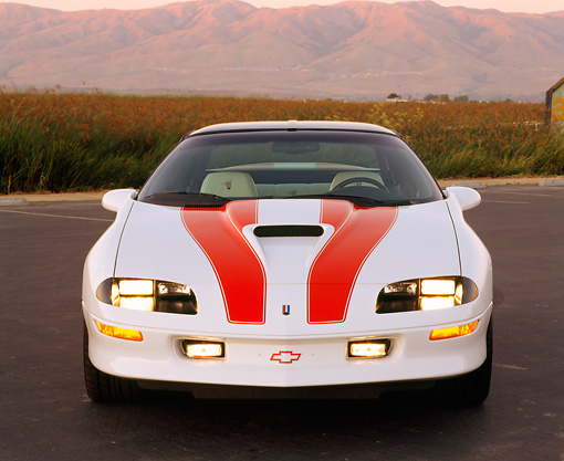 CAM 02 RK0018 06 © Kimball Stock 1997 Chevrolet Camaro SS 30th Anniversary White With Red Stripes Head On View By Mountains
