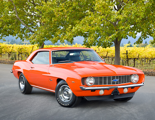 CAM 03 RK0225 01 © Kimball Stock 1969 Chevrolet Camaro ZL-1 Orange 3/4 Front View On Pavement By Trees And Vineyard