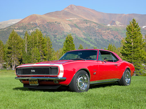 CAM 03 RK0261 01 © Kimball Stock 1967 Chevrolet Camaro Red 3/4 Front View On Grass By Evergreen Trees And Mountain