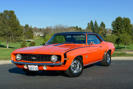 CAM 03 RK0264 01 © Kimball Stock 1969 Chevrolet Camaro SS Orange With Black Top 3/4 Front View On Pavement By Golf Course
