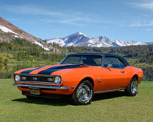 CAM 03 RK0270 01 © Kimball Stock 1968 Chevrolet Camaro SS Hugger Orange 3/4 Front View By Forest Lake And Snowy Mountains