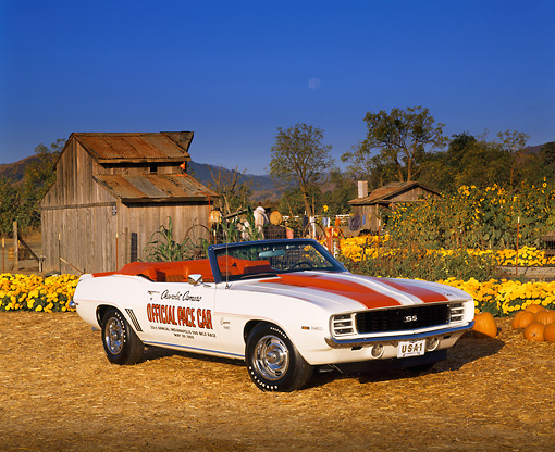 CAM 03 RK0022 01 © Kimball Stock 1969 Chevrolet Camaro Pace Car Convertible White With Hugger Orange Stripes 3/4 Front View At Pumpkin Patch