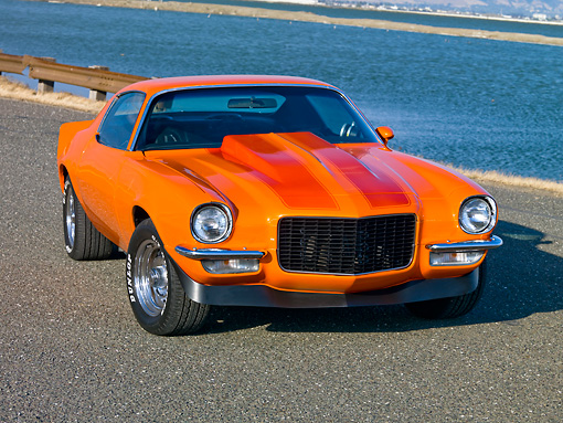 CAM 04 RK0146 01 © Kimball Stock 1970 Chevrolet Camaro Orange With Red Stripes 3/4 Front View On Pavement By Water