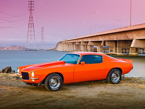 CAM 04 RK0152 01 © Kimball Stock 1970 Chevrolet Camaro Orange With Red Stripes 3/4 Front View On Dirt By Water And Bridge