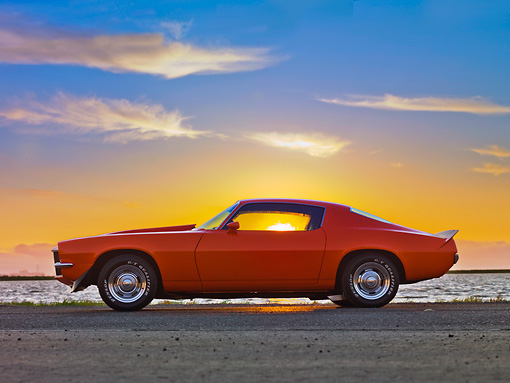 CAM 04 RK0153 01 © Kimball Stock 1970 Chevrolet Camaro Orange With Red Stripes Profile View On Pavement By Water