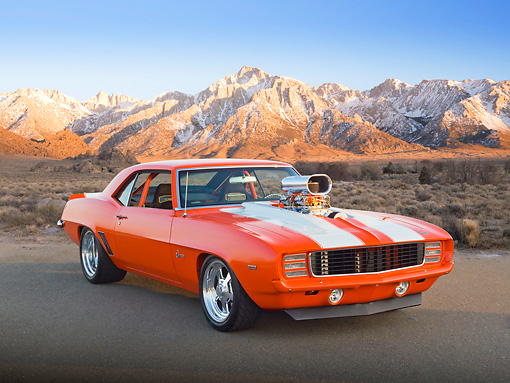CAM 04 RK0238 01 © Kimball Stock 1969 Chevrolet Camaro Orange With White Stripes 3/4 Front View On Pavement By Mountains