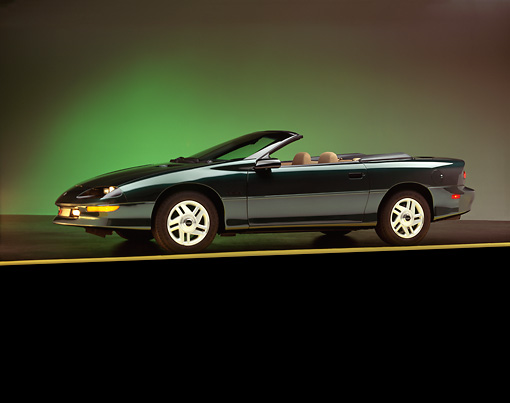 CAM 04 RK0013 02 © Kimball Stock 1994 Chevrolet Camaro Z-28 Convertible Green 3/4 Side View On Yellow Line Studio