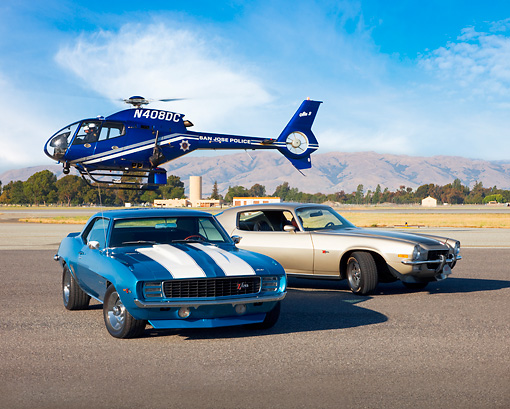 CAM 04 RK0111 01 © Kimball Stock 1969 & 1973 Chevrolet Camaros 3/4 Front View By Helicopter