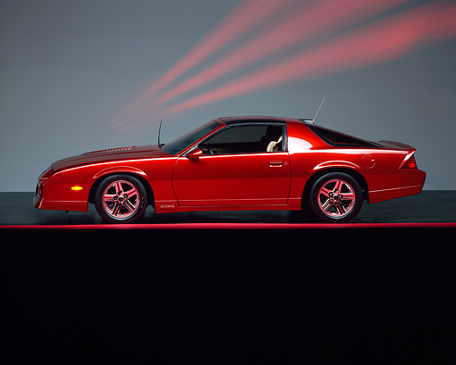 CAM 06 RK0022 02 © Kimball Stock 1986 Chevrolet Camaro Iroc-Z High Performance Red Profile View On Red Line Studio