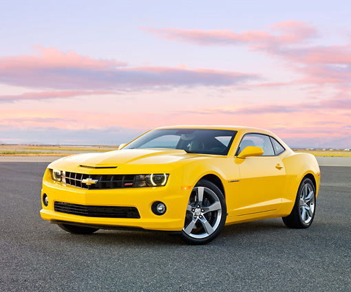 CAM 07 RK0112 01 © Kimball Stock 2010 Chevrolet Camaro RS/SS Yellow 3/4 Front View On Pavement