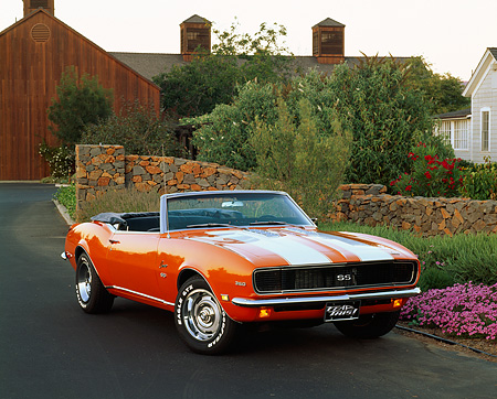 CAM 07 RK0015 01 © Kimball Stock 1968 Chevrolet Camaro RS/SS Convertible Orange White Stripe 3/4 Front View By Flowers And Bushes