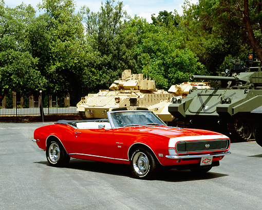 CAM 07 RK0041 02 © Kimball Stock 1968 Chevrolet Camaro RS/SS Convertible Red And White 3/4 Front View On Pavement By Tanks