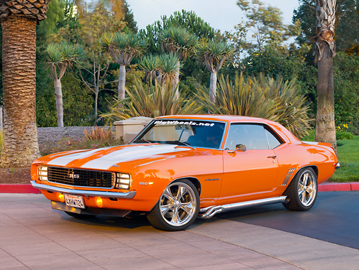 CAM 07 RK0090 01 © Kimball Stock 1969 Chevrolet Camaro RS Orange White Stripe 3/4 Front View On Pavement By Trees