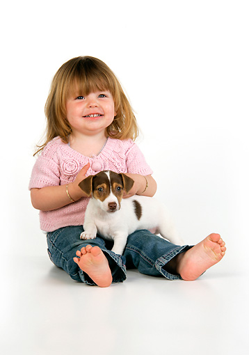 CHD 01 JD0002 01 © Kimball Stock Girl Sitting With Terrier Puppy On Lap