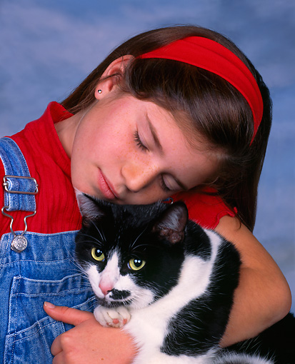CHD 07 RK0007 03 © Kimball Stock Girl With Black And White Adult Cat Studio